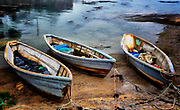 Dories, the draft horses of of the fishing industry are hauled up on the beach resting on their flat bottoms. Rugged, with a substantial cargo capacity and powered by oars, dories could be stacked on fishing boats. Utilitarian but with an aesthetic character.