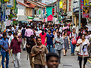"09 JULY 2017 - SINGAPORE: Guest workers from the Indian sub-continent on Dunlop Street in Singapore's ""Little India"" neighborhood. There are hundreds of thousands of guest workers from the Indian sub-continent in Singapore. Most work 5 ½ to six days per week. On Sundays, the normal day off, they come into Singapore's ""Little India"" neighborhood to eat, drink, send money home, go to doctors and dentists and socialize. Most of the workers live in dormitory style housing far from central Singapore and Sunday is the only day they have away from their job sites. Most work in blue collar fields, like construction or as laborers.    PHOTO BY JACK KURTZ"