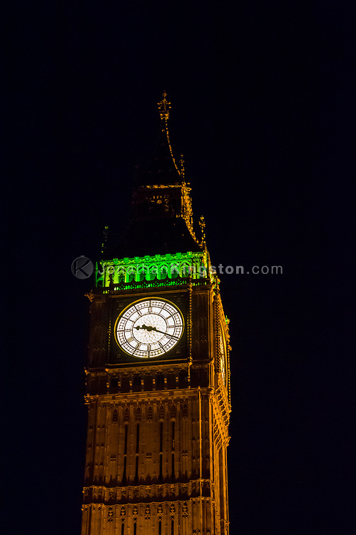 Low-angle night view of Big Ben, officially known as the Elizabeth Tower in London, England.