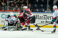 KELOWNA, CANADA - JANUARY 26: Jared Dmytriw #22 of the Vancouver Giants is checked by Conner Bruggen-Cate #20 as Roman Basran #30 of the Kelowna Rockets makes a first period save on January 26, 2019 at Prospera Place in Kelowna, British Columbia, Canada.  (Photo by Marissa Baecker/Shoot the Breeze)