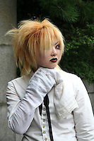 """A wide variety of """"costume play"""" getups are shown here: goths, cartoon characters from Japanese manga, anime,  the sweet-and-innocent frilly look or combinations in between (goth lolly)  Every Sunday, these cosplay characters converge on Harajuku, Tokyo's fashion quarter. Most casual observers say that cosplay is a reaction to the rigid rules of Japanese society. But since so many cosplay girls congregate in Harajuku and Aoyama - Tokyo headquarters of Fendi, Hanae Mori and Issey Miyake, others consider it is a reaction to high fashion. Whatever the cause, cosplay aficionados put a lot of effort into their clothing and makeup."""
