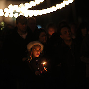 A young girl at a townwide community vigil on Sherman Green. Fairfield, Connecticut after the mass shootings at Sandy Hook Elementary School, Newtown, Connecticut, USA. 17th December 2012. Photo Tim Clayton