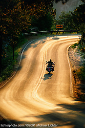 """The Journey, Custer State Park, SD. 2000<br /> <br /> Limited Edition Print from an edition of 50. Photo ©2000 Michael Lichter.<br /> <br /> The Story:A number of years ago, Harley-Davidson ran a great ad campaign headlined, """"It's the Journey, not the Destination."""" On my bike, the phrase comes to mind like a mantra. Shedding the protective cage, bikers become one with the environment. There's no sound insulation or climate control separating you from out there. You become one with the stifling heat and one with the freezing cold. You become the road and the destination drifts away."""