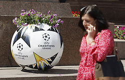 May 18, 2018 - Kiev, Ukraine - An Ukrainian woman walks past a flower bed with the logo the UEFA Champions League final in central Kiev, Ukraine, 18 May, 2018. The football UEFA Champions League final match between Real Madrid and Liverpool FC next May 26 at the NSC Olimpiyskiy Stadium. (Credit Image: © Str/NurPhoto via ZUMA Press)