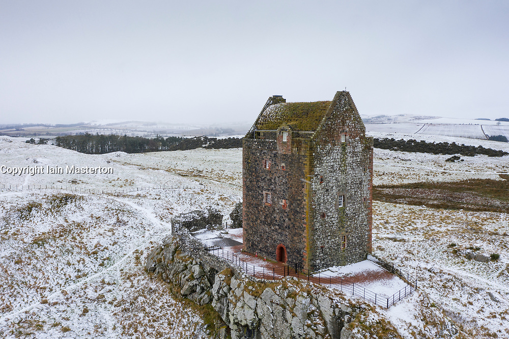 Smailholm, Scottish Borders, Scotland, UK. 2 February 2021. Views of Smailholm Tower near Kelso in the Scottish Borders during snowfalls today. The snow gives a bleak wintry look to the ancient Peel Tower tower built in 15th or 16th Century. Much of the Scottish Borders was covered in snow today.  Iain Masterton/Alamy Live News