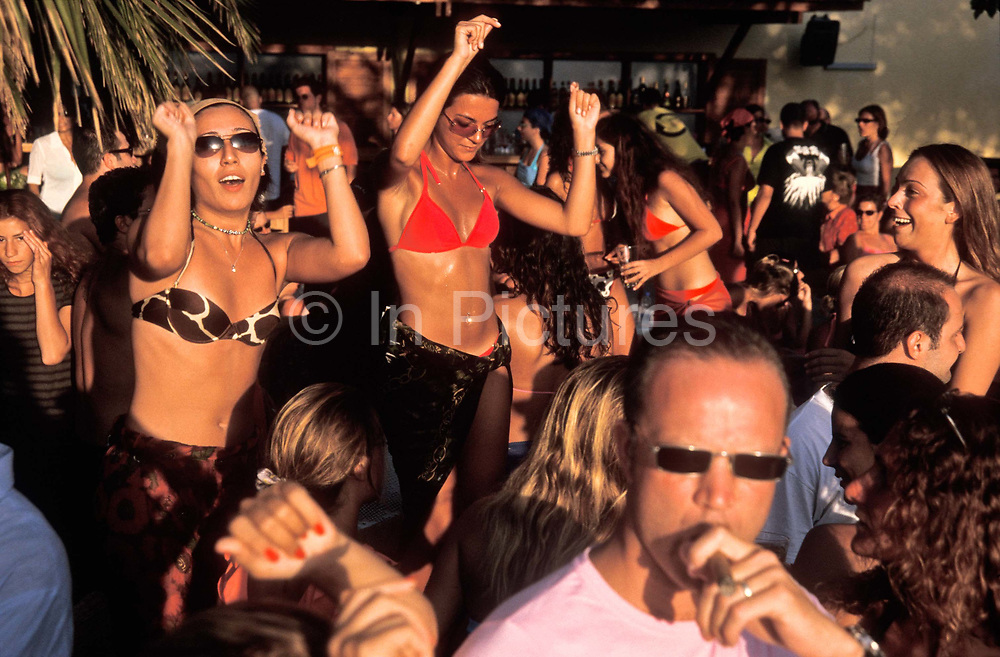 At the exclusive Havana Beach Club outside the seaside resort town of Bodrum on the Aegean sea a crowd of young, wealthy, mostly Istanbuli residents dance through the afternoon and into next morning at the height of the summer season, Turkey