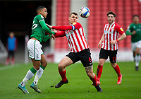 Football - 2020 / 2021 Sky Bet League One - Sunderland vs Lincoln City - Stadium of Light<br /> <br /> Max Power of Sunderland vies with Cohen Bramall of Lincoln City<br /> <br /> Credit: COLORSPORT/BRUCE WHITE