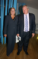 ADAM BOULTON and his wife ANJI HUNTER at a party to celebrate the publication of Glass Houses by Sandra Howard held at Tamesa, Oxo Tower Wharf, Barge House Street, London SE1 on 5th September 2006.<br /> <br /> NON EXCLUSIVE - WORLD RIGHTS