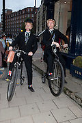 Penny Farthing double-act, Pearly King performing with a barrel organ, The Pimlico Road Summer party. London SW1. 9 June 2009