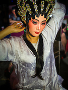 18 JANUARY 2015 - BANGKOK, THAILAND: A performer with the Sai Yong Hong Opera Troupe adjusts her hair extensions before a performance at the Chaomae Thapthim Shrine, a Chinese shrine in a working class neighborhood of Bangkok near the Chulalongkorn University campus. The troupe's nine night performance at the shrine is an annual tradition and is the start of the Lunar New Year celebrations in the neighborhood. The performance is the shrine's way of thanking the Gods for making the year that is ending a successful one. Lunar New Year, also called Chinese New Year, is officially February 19 this year. Teochew opera is a form of Chinese opera that is popular in Thailand and Malaysia.             PHOTO BY JACK KURTZ