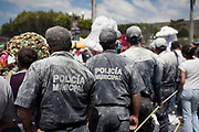 Police covered in talcum powder. The annual Carnival in Zoque Coiteco, a district of Chiapas in Southern Mexico happens in the five days preceeding Ash Wednesday along with Carnival throughout the Americas. Participants dress in colourful costumes with masks depicting famous political and entertainment figures, and throw talcum powder at each other.