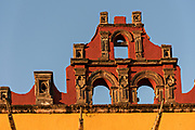 Spanish Colonial style architecture on the Universidad de Leon building on the Plaza de la Soledad in the historic district of San Miguel de Allende, Guanajuato, Mexico.