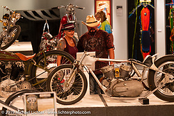Checking out the Arkansas Traveler, a Harley-Davidson K Model drag bike built and piloted by Sam Satterley (aka Slidin' Sammy) in the 1960's that was found and put back together again by custom bike builder Dan Rognsvoog and on view in the What's the Skinny Exhibition (2019 iteration of the Motorcycles as Art annual series) at the Sturgis Buffalo Chip during the Sturgis Black Hills Motorcycle Rally. SD, USA. Thursday, August 8, 2019. Photography ©2019 Michael Lichter.