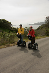 Couple on Segways, each on a Segway, on Angel Island State Park in San Francisco Bay, California, CA. Model released..Photo camari220-70426..Photo copyright Lee Foster, www.fostertravel.com, 510-549-2202, lee@fostertravel.com.
