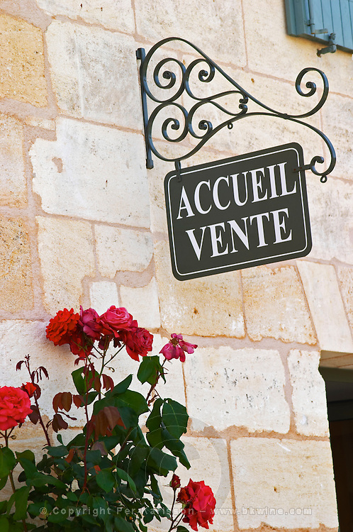 The visitors' reception room with a rose bush with gigantic flowers and a sign saying 'accueil vente' (reception, sales), closeup of the sign Chateau Thieuley La Sauve Majeure Entre-deux-Mers Bordeaux Gironde Aquitaine France