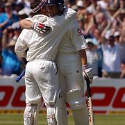 England's Matthew Hoggard hugs Graham Thorpe after he made his tonne against Sri Lanka.