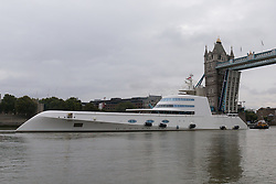 © Licensed to London News Pictures. 10/09/2016. LONDON, UK.  Motor Yacht A leaves London under Tower Bridge on the River Thames early this morning. The £225m superyacht, owned by Russian billionaire, Andrey Melnichenko (known as the King of Bling) has spent the last week moored next to HMS Belfast during a London visit. Motor Yacht A is 390ft long, was designed by Philippe Starck, inspired by a submarine and is now reported to be up for sale because Melnichenko is building a new superyacht.  Photo credit: Vickie Flores/LNP