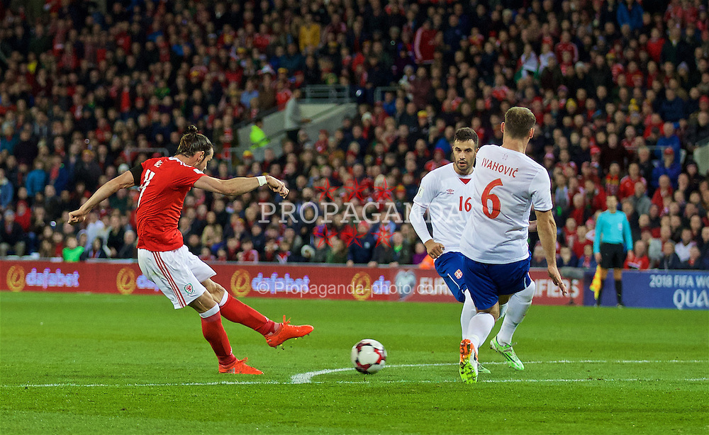 CARDIFF, WALES - Saturday, November 12, 2016: Wales' Gareth Bale scores the first goal against Serbia during the 2018 FIFA World Cup Qualifying Group D match at the Cardiff City Stadium. (Pic by David Rawcliffe/Propaganda)