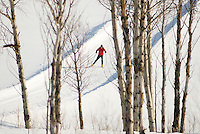 A young woman nordic skate skis at Jackson Hole Mountain Resort in Jackson Hole, Wyoming.