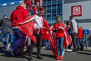 Two young Wales fans outside the ground ahead of the UEFA European 2020 Qualifier match between Wales and Slovakia at the Cardiff City Stadium, Cardiff, Wales on 24 March 2019.