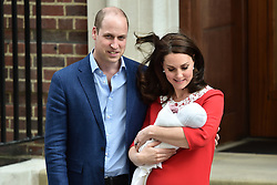 The Duke and Duchess of Cambridge with the newly born Prince outside the Lindo Wing at St Mary's Hospital in Paddington, London. Photo credit should read: Matt Crossick/EMPICS Entertainment