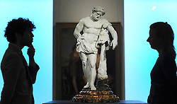 © Licensed to London News Pictures. 01/12/2011, London, UK. A very rare and important 82cm high porcelain figure of Hercules created at the Doccia factory in Tuscany in 1753-55 is to be sold at Bonhams, New Bond Street, London on 7th December 2011.  This is the first time that a Doccia figure of this size has come to auction and the piece is estimated to sell for £300,000-500,000.. Photo credit : Stephen Simpson/LNP