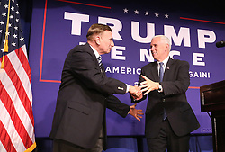 Republican vice presidential candidate Mike Pence thanks U.S. Rep. John Mica (left) at a rally on Monday, Oct. 31, 2016 in Maitland, FL, USA. Photo by Joe Burbank/Orlando Sentinel/TNS/ABACAPRESS.COM