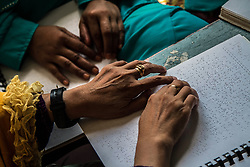June 1, 2017 - Medan, North Sumatra, Indonesia - An Indonesian blind woman as read the Qur'an with his fingers in Braille during the holy month of Ramadan in the middle of the Blind Indonesia Unity on June 1, 2017 in Medan, North Sumatra Province, Indonesia. People to fill the holiest month of the Islamic calendar, they refrain from eating, drinking, smoking and sex from dawn to dusk by following the Qur'an tadarus. (Credit Image: © Ivan Damanik via ZUMA Wire)