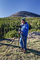 Photographer near Elk CreekVermejo Park Ranch, New Mexico, USA.