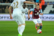 Aston Villa's Ashley Westwood (r) attacks the Swansea midfield.  Barclays Premier league match, Swansea city v Aston Villa at the Liberty Stadium in Swansea, South Wales on Saturday 19th March 2016.<br /> pic by  Carl Robertson, Andrew Orchard sports photography.