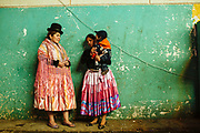 """Maria Eugenia Herrera Mamani, alias """"Claudina the Cursed"""", talks with Sarita, alias """"The Romantic"""", before start the wrestling's show in a Community Center El Alto. The Cholitas wear the traditional costumes of Aymara people during wrestling shows, Bolivia, February 26, 2012. <br /> SPANISH: Maria Eugenia Herrera Mamani alias Claudina La Maldita  talks to Sarita alias La Romantica before starting the wrestling's show in a Community Center El Alto. The Cholitas when go into the ring to wrestle wear the traditional costumes of Aymara people, El Alto, Bolivia, February 26, 2012."""