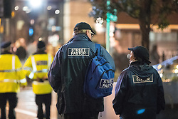 """© Licensed to London News Pictures . 17/12/2016 . Manchester , UK . Street Pastors outside the Printworks . Revellers out in Manchester City Centre overnight during """" Mad Friday """" , named for being one of the busiest nights of the year for the emergency services in the UK . Photo credit : Joel Goodman/LNP"""