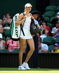 Naomi Broady walks on to court on day two of the Wimbledon Championships at the All England Lawn Tennis and Croquet Club, Wimbledon.