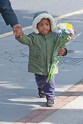 ©Licensed to London News Pictures 28/09/2020  <br /> Croydon, UK. A young boy with flowers for Sgt Matt Ratana at Croydon Custody Centre. The murder investigation continues after the death of police sergeant Matt Ratana at the Croydon Custody Centre in South London last week. Photo credit:Grant Falvey/LNP
