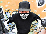 Street portrait of a rapper with a mask