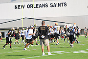 NFL-The Super Bowl Champs The New Orleans Saints are seen running plays in the hot afternoon sun during Training camp in Metairie Louisiana Sunday August 1,2010. QB Drew Brees was throwing passes to his receivers and Reggie Bush is healthy and looked sharp in practice. amp drills. Lance Moore 16, makes a great catch from QB Drew Brees and reacts to the catch with a hugh smiley face. Brees and Bush sign autographs for the fans after practice Sunday. Coach Sean Payton feels the team is in great shape and focused on the season and repeating their championship season. Saints Owner Tom Benson shows his SuperBowl ring to the fans Photo© Suzi Altman