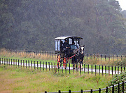 Tourists enjoy  traditional jaunting cart ride in the pouring rain in Killarney, County Kerry, Ireland.<br /> <br /> Photo: Don MacMonagle <br /> e: info@macmonagle.com