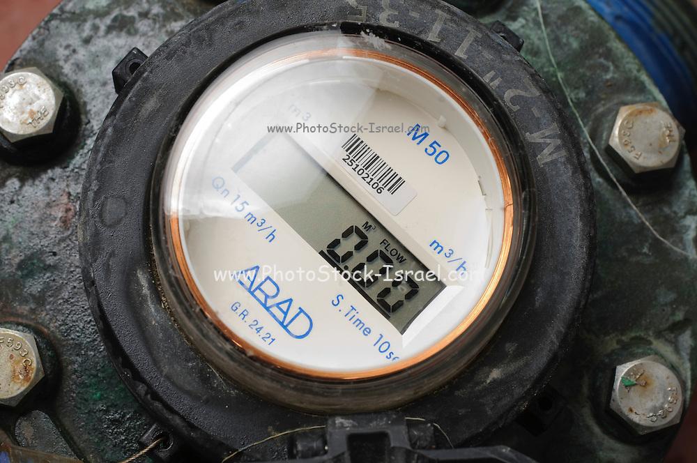 Water flow meter with digital display measures the hourly flow of the water in cubic metres