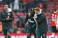 Football - 2019 / 2020 Premier League - Southampton vs. Newcastle United<br /> <br /> Matt Ritchie of Newcastle jokes with goal scorer Allan Saint-Maximin after the final whistle at St Mary's Stadium Southampton<br /> <br /> COLORSPORT/SHAUN BOGGUST