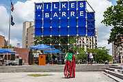Wilkes-Barre, PA (July 11, 2020) -- Wilkes-Barre business owner Carmen Tinson wears an African American Flag as a cape during the Back Lives Matter NEPA United Movement event on Public Square.