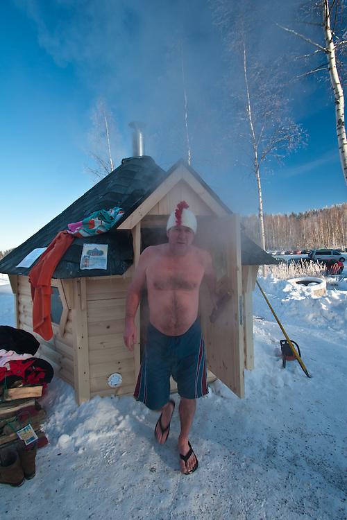 The competitor Tapani Korkeamaki enjoys sauna in Finnish Ice Swimming Championships in Ellivuori, Finland.