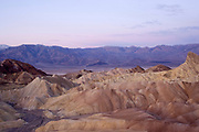 Sunrise turns the Panamint Mountains pink.Death Valley National Park, California