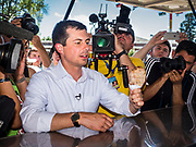 "13 AUGUST 2019 - DES MOINES, IOWA: PETE BUTTIGIEG with the ""pork chop on a stick"" he bought at the Iowa State Fair. Buttigieg, the Mayor of South Bend, Indiana, is running to be the Democratic nominee for the US presidency. He spoke at the Des Moines Register Political Soap Box at the Iowa State Fair and then toured the fairgrounds. Iowa has the first event of the presidential selection cycle. The Iowa Caucuses are February 3, 2020.               PHOTO BY JACK KURTZ"