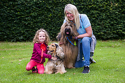 Five-year-old Sophie Murphy of Stow in the Borders with her cocker spaniel Mabel, who won first prize for the Dog that Looked Most Like Its Owner during a Dogs' Day Out at Traquair House. Second prize winner was Sue Steel, a dog walker of Romanno Bridge near West Linton, with her five-year-old briard Barney. Pic copyright Terry Murden @edinburghelitemedia