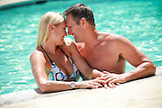 Good looking Romantic Couple in the Pool