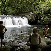 A family finds solitude at the end of a hike to a deserted swimming hole in Hawaii.