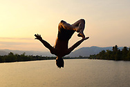 A local man from the colonial town of Kampot in Cambodia is jumping in the Kampong Bay River.<br /> Photo by Lorenz Berna
