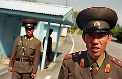 Panmunjom, North Korea, April/May 2004. Panmunjom in the Demilitarized Zone. Korean soldiers just outside the JSA (Joint Security Area), a couple of white and blue huts, half on North, half on South Korean territory. Peace talks continue up until this day. (Photo by Teun Voeten) *** Please Use Credit from Credit Field ***
