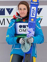 Winner Sarah Hendrickson of USA at medal ceremony during Normal Hill Individual Competition at FIS World Cup Ski jumping Ladies Ljubno 2012, on February 11, 2012 in Ljubno ob Savinji, Slovenia. (Photo By Vid Ponikvar / Sportida.com)