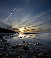 Vertical Panorama of Totland Bay with Cirrus Clouds at Sunset. <br /> <br /> Everything just fell perfectly into place, as a photographer, I don't think I could ask for any more than this.<br /> <br /> Created from two frames shot with the Sigma 10-20mm at f4.0 1/320<br /> <br /> Part of the Ocean Seen - Oceanic Photography Exhibition.<br /> <br /> Sponsored by Wightlink - Dimbola Museum & Galleries, Freshwater Bay, Isle of Wight - 29th June to 2nd September 2012.<br /> <br /> A collaborative summer show, bringing together three great oceanic photographers to celebrate the way we interact with our great British coastline.